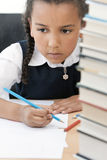 African American School Girl Writing In Class Stock Image