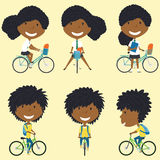 African American school girls on the bikes Royalty Free Stock Image