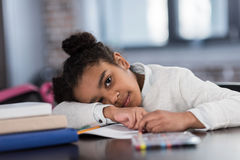African american schoolgirl doing homework Royalty Free Stock Image