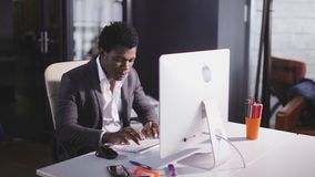 African american man type on keyboard in the modern office. African american serious man working at office stock video