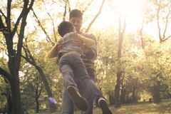 African American single father in park holding his daugh stock photos