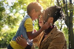 African American single mother in park with her daughter. Face to face Stock Images