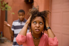 African-American single-parent family. Good-looking single-parent mom and son Royalty Free Stock Images