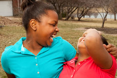 African American sisters and best friends laughing. Stock Photography