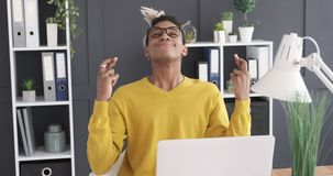Businessman crossing fingers and wishing the best. African american sitting with crossed fingers and wishing for the best at work stock footage