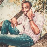 African american sitting on a tree Royalty Free Stock Photos