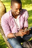 African american sitting on a tree Royalty Free Stock Image