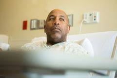 African American man in the hospital. African American sleeping in the hospital bed Royalty Free Stock Photos