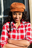 African American smiling woman. Wearing a hat Royalty Free Stock Photos