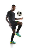 African American Soccer Player Bouncing Ball on Knee. Isolated over white background stock photo