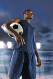 African American Soccer Player Holding Ball Stock Images