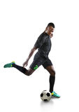 African American Soccer Player Kicking Ball Stock Images