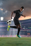 African American Soccer player Performing Back Kick Stock Photo