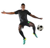 African American Soccer Player. Playing isolated over white background stock photos