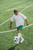 African american soccer player training with ball Stock Image