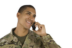 African American Soldier on the Phone. A military man laughs on the phone Royalty Free Stock Images