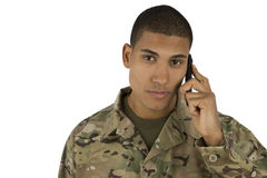 African American Soldier talking on the Phone. A serious looking military man on the phone royalty free stock photo