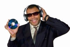 African-American sorridente che mostra un disco compatto Immagini Stock