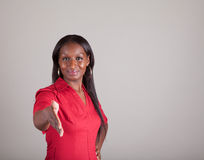 African American Spokeswoman with hand extended. African American woman with American Indian heritage acting as a spokesperson holding out her hand with room for Royalty Free Stock Photo