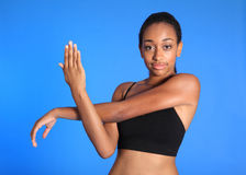 African American sports woman shoulder stretch Stock Photos
