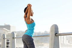 African american sports woman stretching arms outside Royalty Free Stock Images