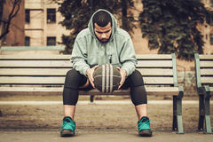 African-american streetball player resting outdoors Royalty Free Stock Photography