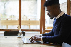 African american student of business school in dark sweater and white shirt Royalty Free Stock Photo