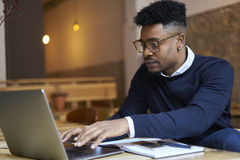 African american student of business school in dark sweater and white shirt Stock Photography