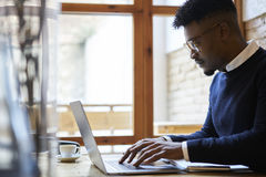 African american student of business school in dark sweater and white shirt Royalty Free Stock Images