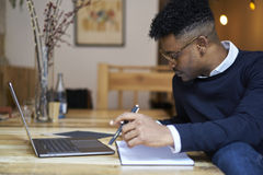 African american student of business school in dark sweater and white shirt Stock Images