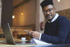 African american student of business school in dark sweater and white shirt Royalty Free Stock Photos