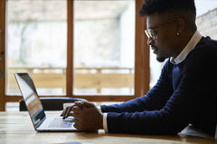 African american student of business school in dark sweater and white shirt Stock Photo