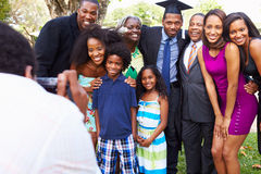 African American Student Celebrates Graduation. With Extended Family Smiling To Camera royalty free stock photos