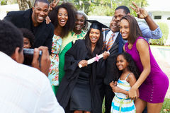 African American Student Celebrates Graduation. Happy African American Student Celebrates Graduation Getting Their Picture Taken stock image