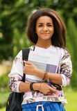 African-american student girl in a park Stock Images