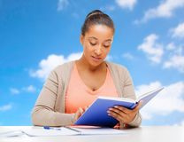 African american student girl reading textbook royalty free stock photo