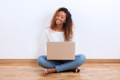African American student girl using a laptop computer - black pe Stock Images