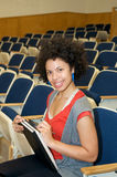 African American student in lecture hall Stock Image