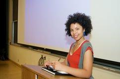 African American student speech podium. African American student giving a speech at the podium Royalty Free Stock Image