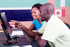 African american students. Two adult african american students studying computer together royalty free stock images