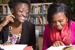 African American Students Playful in the Library Royalty Free Stock Image