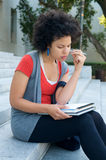 African American studying outdoor. African American Student girl on campus Stock Photos