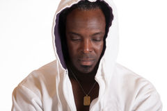 African American in sweat suit jacket with hood Royalty Free Stock Images