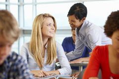 African American teacher helping student in class Royalty Free Stock Images