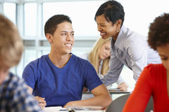 African American teacher helping student in class Stock Images