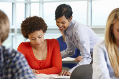 African American teacher helping student in class Stock Photography