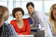 African American teacher helping student in class Royalty Free Stock Photos