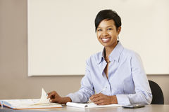 African American teacher working at desk Royalty Free Stock Photography