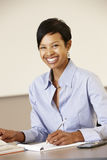 African American teacher working at desk Stock Photography