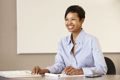 African American teacher working at desk Stock Images